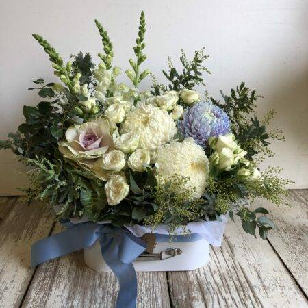 Blue baby suitcase flower arrangement
