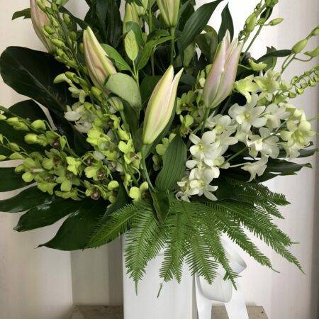 White vase lilies and orchids