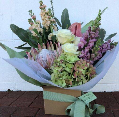 Pastel flowers in a box arrangement