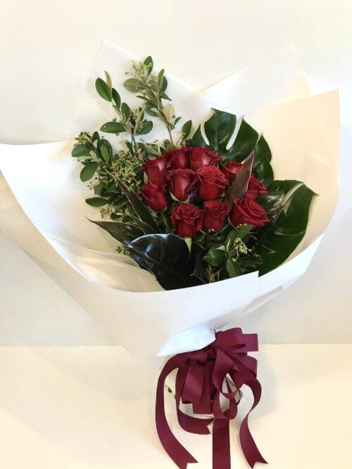 Dozen red roses in a bouquet